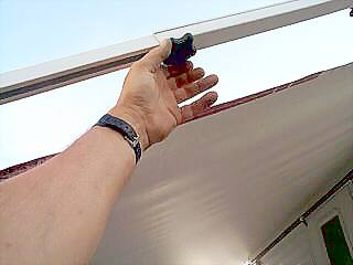 Tighten the RV awning rafter knobs on both rafters